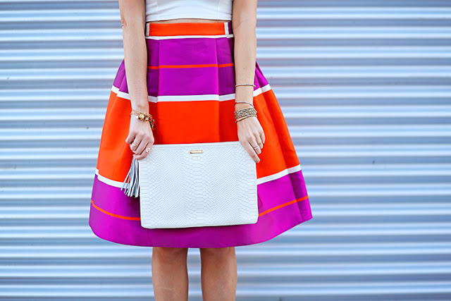 colorful midi skirt with white clutch