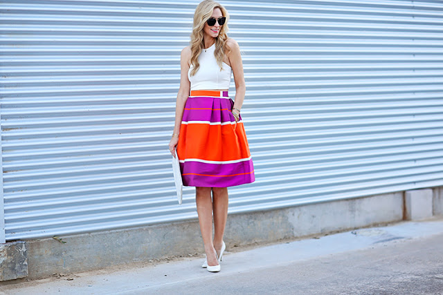 white crop top and heels with a bright skirt