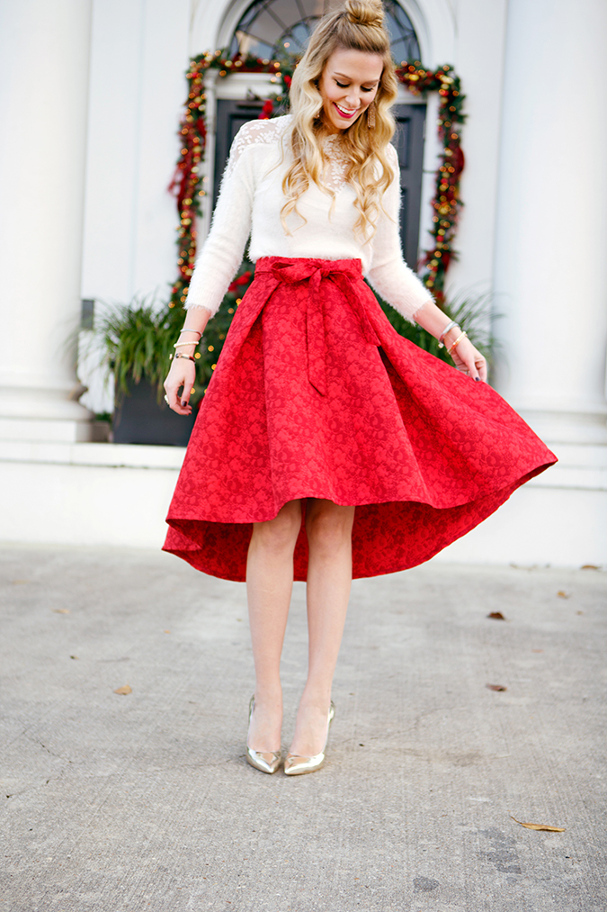 red midi skirt paired with a white mohair sweater for a holiday party outfit idea