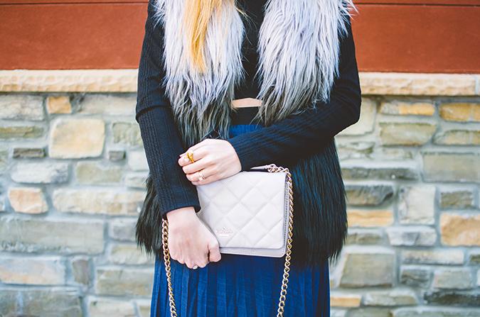 wear a fur vest over a crop top