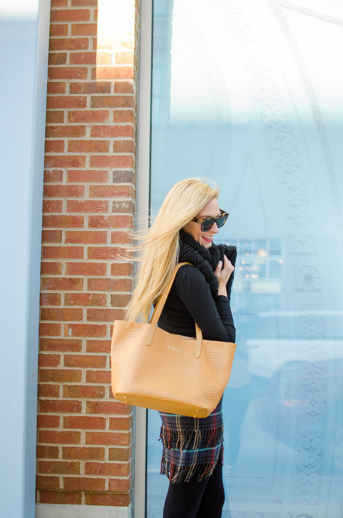 pair your camel handbag with classic black pieces in your wardrobe