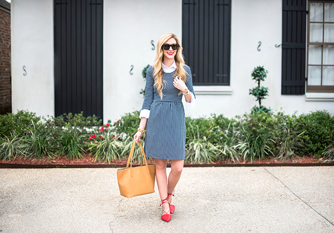 Step into spring with the classics - striped shirt dress, white collared shirt, red lace up flats, camel tote