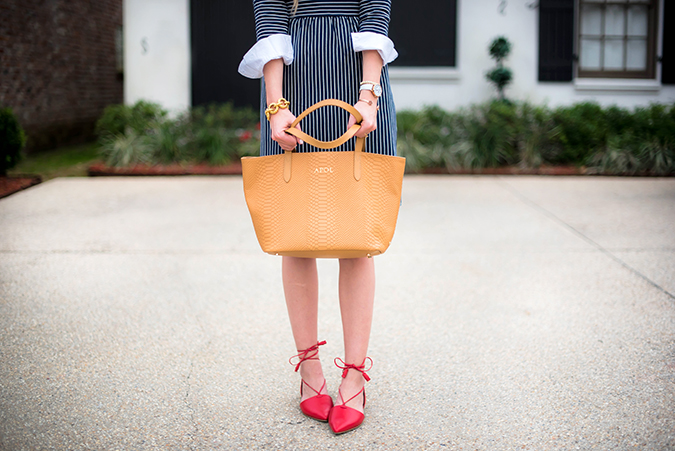 Step into spring with the classics - striped shirt dress, white collared shirt, red lace up flats, personalized tote