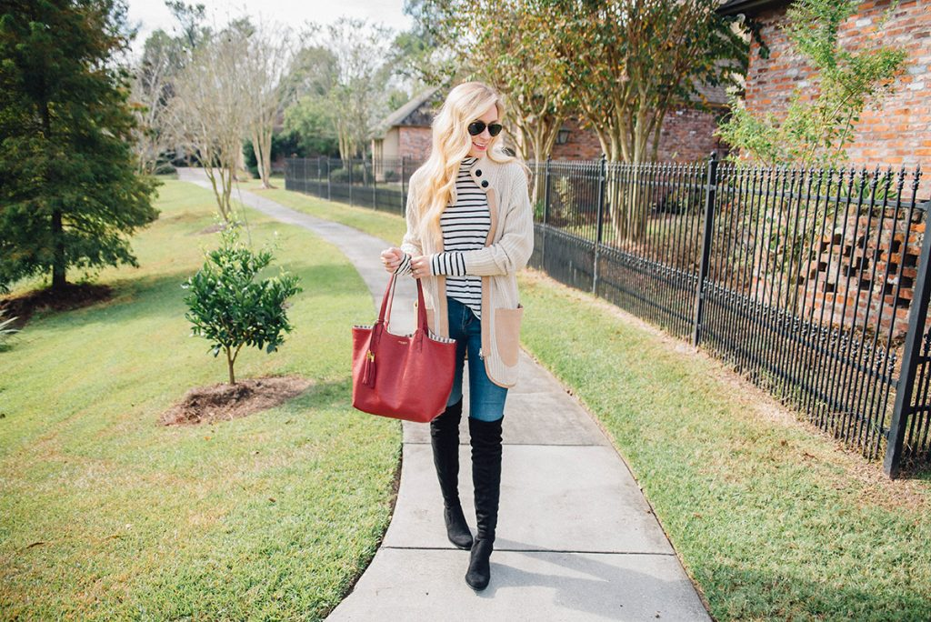 layer an oversized cardigan over stripes with OTK boots