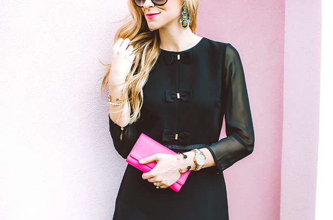 LBD with pink clutch