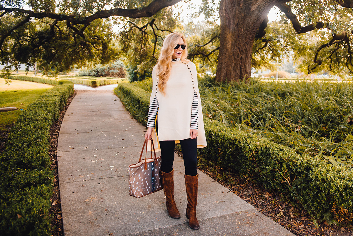 ivory cape and riding boots