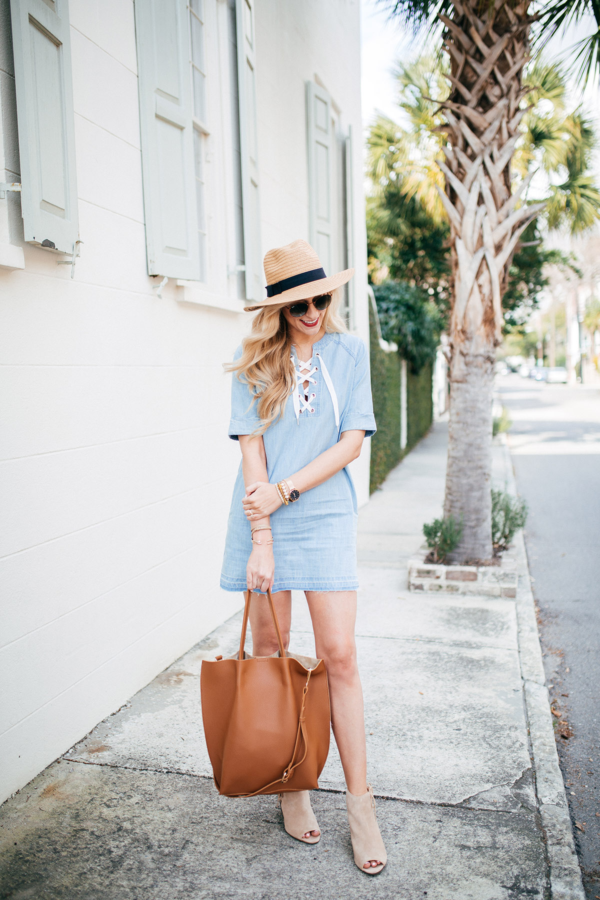 The three must-have spring accessories you'll wear all season long: wedge booties | cognac leather tote | wide brim hat